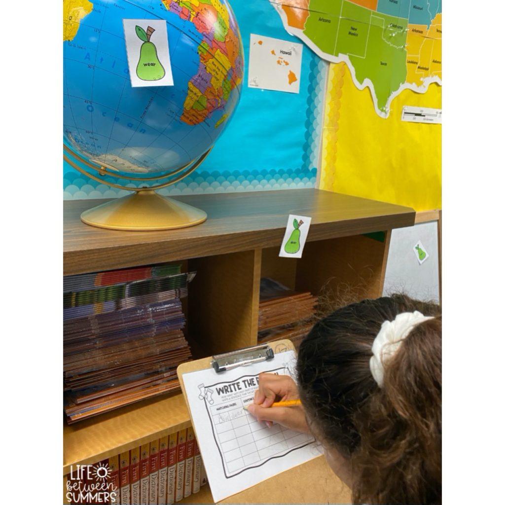 Student doing write the room activity to practice homophones